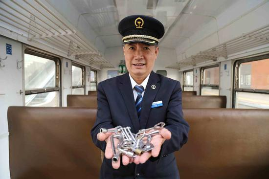 Train attendant holds keys to railway progress