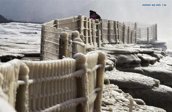 Breathtaking winter scenery of Hukou Waterfall
