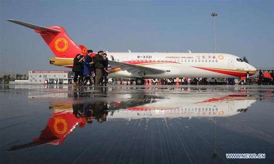 The ARJ21, China's first commericial regional aircraft, is parked at the Shuangliu International Airport in Chengdu, capital of southwest China's Sichuan Province, Nov. 29, 2015.  (Xinhua/Pei Xin)