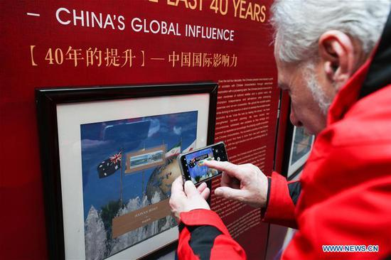 Stamp exhibition in Belgium marks 40th anniversary of China's reform, opening up