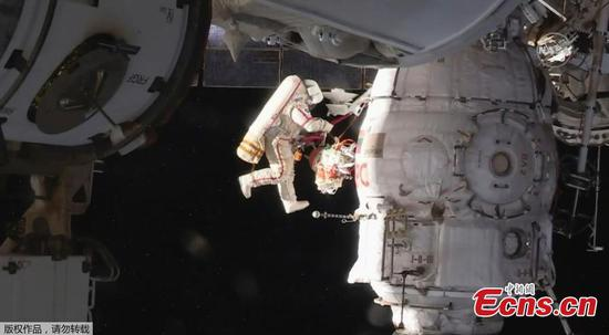 Russian spacewalkers complete crew vehicle inspection