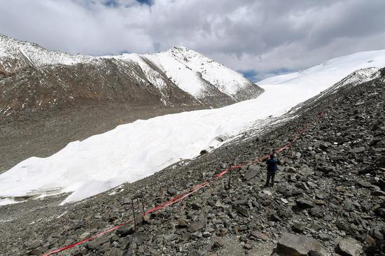 A photo taken on May 23, 2015, shows a shrinking glacier in the Qilian Mountains, Northwest China's Gansu province. (Photo/Xinhua)