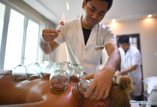 A Russian tourist receives cupping treatment at a sanatorium in Sanya, south China's Hainan Province, June 2, 2018. (Xinhua/Guo Cheng)