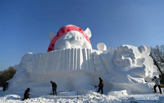 Giant snow sculpture welcomes Year of the Pig in Harbin