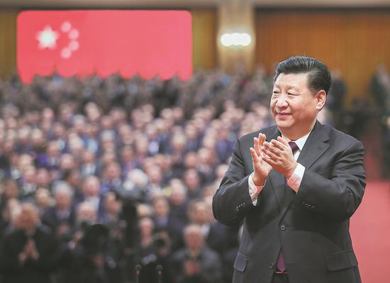 President Xi Jinping attends a grand gathering celebrating the 40th anniversary of the country's reform and opening-up at the Great Hall of the People in Beijing on Tuesday. [Photo/Xinhua]