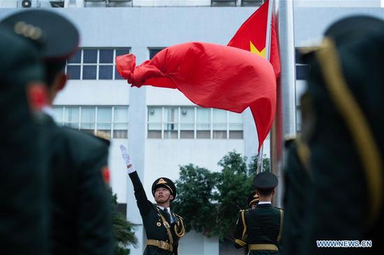 Flag-raising ceremony held to celebrate 19th anniv. of Macao's return to motherland