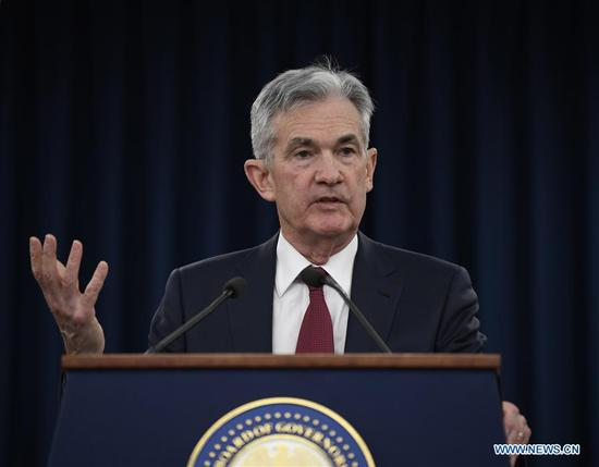 U.S. Fed raises rates, but signals slower pace of hikes next year