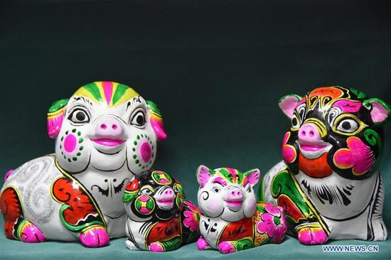 Artists busy making clay sculptures for upcoming Chinese lunar new year