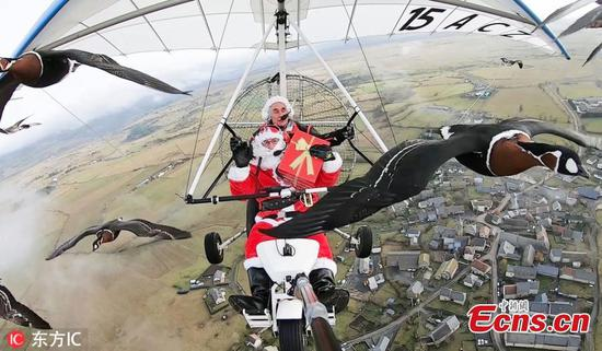 Santa flies through skies in France with flock of geese