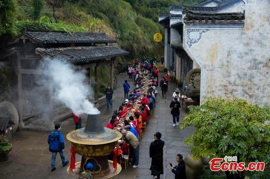 Long-table feast held in ancient village
