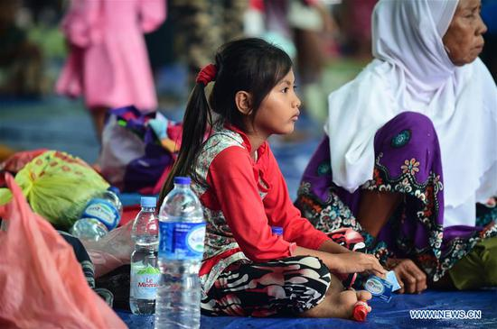 Tsunami survivors rest at temporary shelter in Banten Province, Indonesia