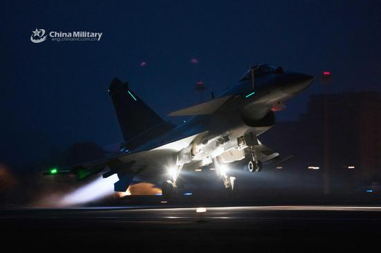 J-10 fighter jets take off at night