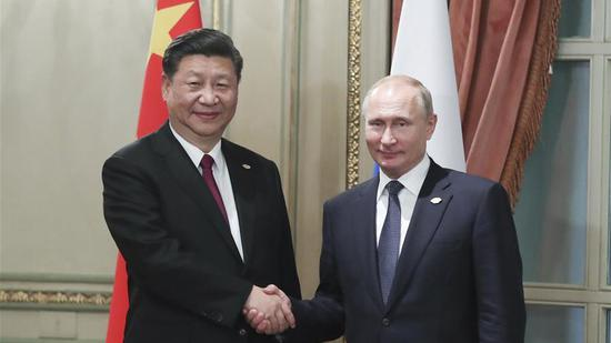 Chinese President Xi Jinping meets with his Russian counterpart Vladimir Putin in Buenos Aires, Argentina, November 30, 2018. (Photo/Xinhua)