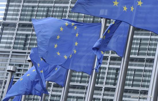 EU flags flutter outside the EU headquarters in Brussels, Belgium. (Photo/Xinhua)