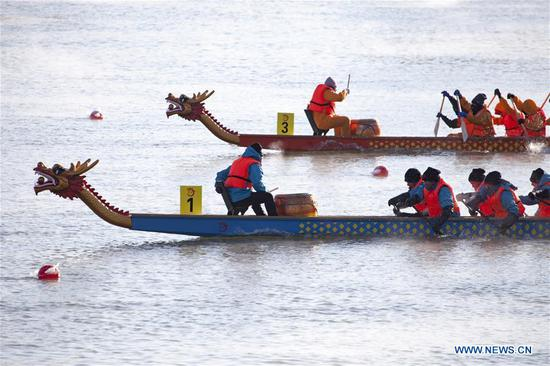 Winter dragon boat race held in NE China's Jilin
