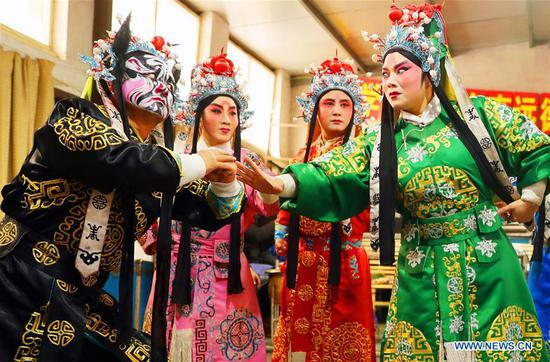 Actors of Jin opera troupe busy rehearsing to greet upcoming new year