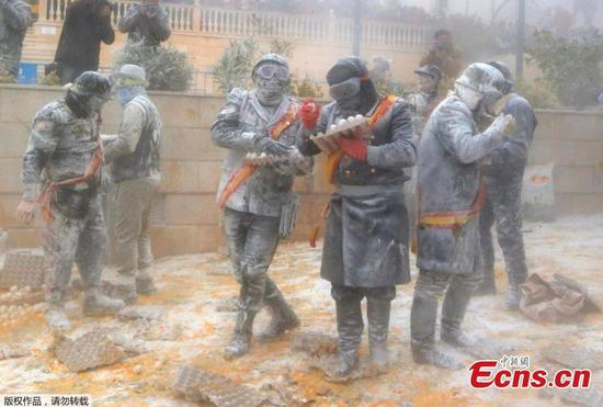 Flour and eggs are weapons of war in this Spanish town
