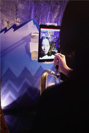 Tian Jimo is gifted her personal beer tap which could only be activated through facial recognition. (Photo provided to chinadaily.com.cn)