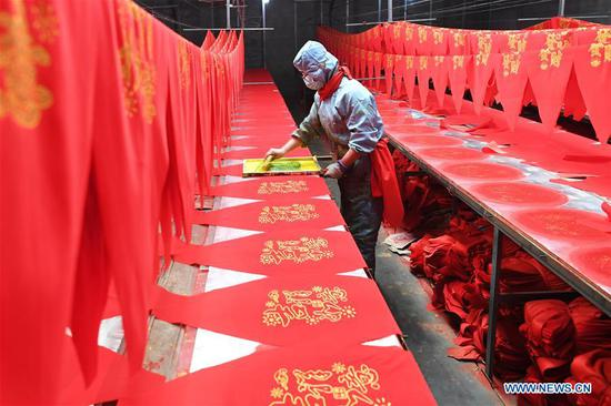 Villagers work in lantern workshop for upcoming peak sales season of Spring Festival in Shanxi