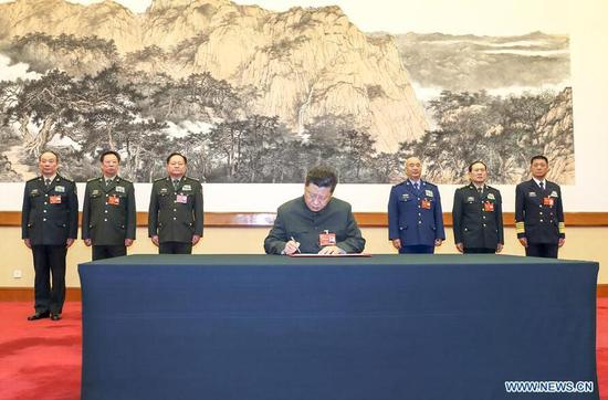 Xi orders armed forces to enhance combat readiness