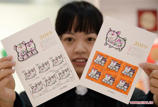 China issues special zodiac stamps in honor of Year of Pig