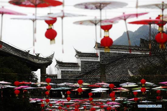 Festival decorations hung to greet upcoming Lunar New Year in Zhuoshui ancient town in Chongqing