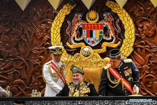 File photo taken on July 17, 2018 shows Malaysia's King Sultan Muhammad V (C) attending a parliament meeting in Kuala Lumpur, Malaysia. (Xinhua/Chong Voon Chung)