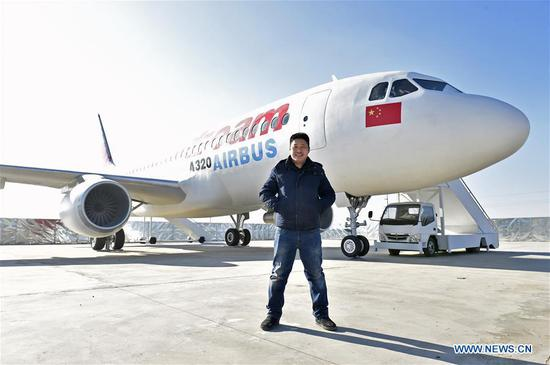 Chinese farmer to finish building full-size plane model in Liaoning