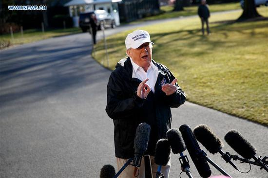 U.S. President Donald Trump speaks to reporters before leaving the White House in Washington D.C., the United States, on Jan. 10, 2019. Donald Trump said Thursday he