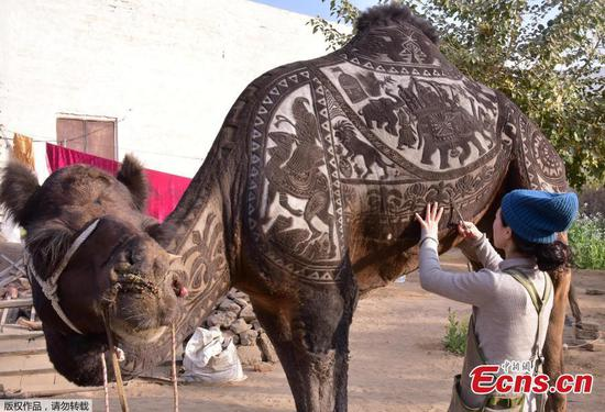 Japanese hairdresser creates exquisite artwork on camel coat