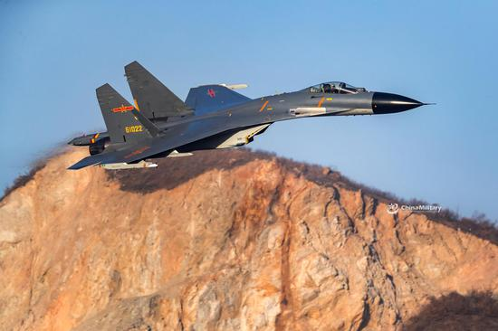 J-11B fighter jet flies through valleys