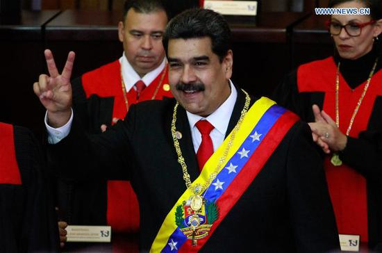 Venezuelan President Nicolas Maduro (C) gestures during the presidential inauguration ceremony in Caracas, Venezuela, on Jan. 10, 2019. Nicolas Maduro was sworn in before the Supreme Court of Justice to begin a new six-year term on Thursday. (Xinhua/Andrea Romero)