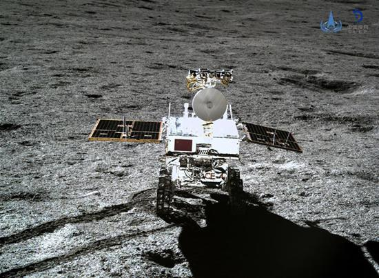 Photo taken by the lander of the Chang'e-4 probe on Jan. 11, 2019 shows the rover Yutu-2 (Jade Rabbit-2). China announced Friday that the Chang'e-4 mission, which realized the first-ever soft-landing on the far side of the moon, was a complete success. With the assistance of the relay satellite Queqiao (Magpie Bridge), the rover Yutu-2 (Jade Rabbit-2) and the lander of the Chang'e-4 probe took photos of each other. (Xinhua/China National Space Administration)