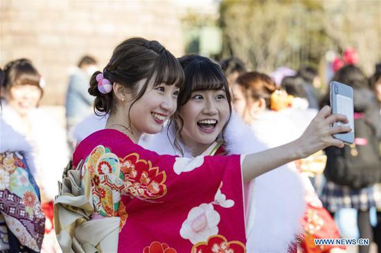 Japanese girls dressed up celebrate Coming of Age at Tokyo Disneyland