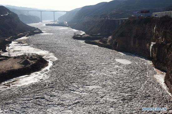 Frozen Hukou Waterfall on Yellow River