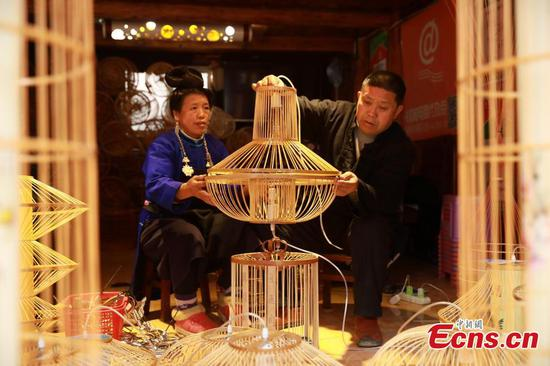 Village busy making bird cage-shaped lanterns for Chinese New Year