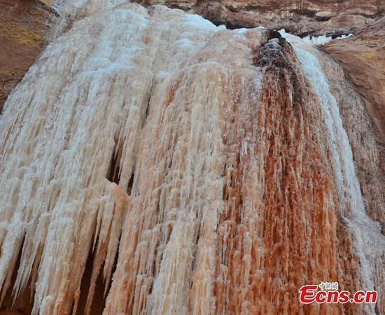 Ice waterfall formed on Gansu cliffs