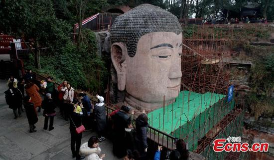 Largest Buddhist sculpture receives facelift