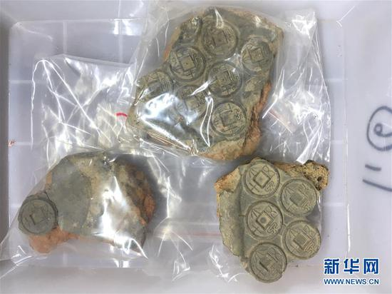 Coins and moulds 2000 years ago found in Henan
