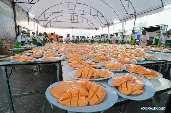 Mango sticky rice made in Thailand's Bangkok aiming to set Guinness World Record