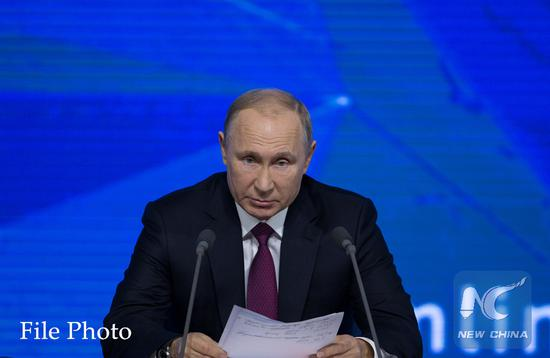 Putin's approval rating slightly down in Jan.: poll