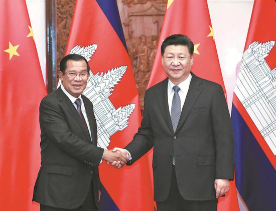 President Xi Jinping meets with Cambodian Prime Minister Samdech Techo Hun Sen at the  Diaoyutai State Guesthouse in Beijing on Monday. Xi said bilateral relations have developed at a high level. (PANG XINGLEI / XINHUA)