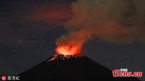 Mexico's Popocatepetl volcano belches glowing rock, ash