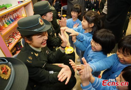 PLA troops in Hong Kong mark Spring Festival with children