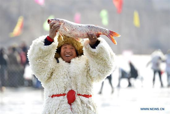 Winter fishing tourism festival held in Hohhot, north China's Inner Mongolia