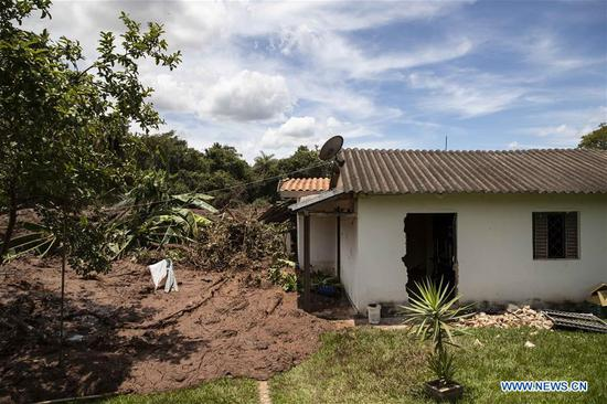 Photo taken on Jan. 27, 2019 shows a destroyed house at the area affected by the collapse of a tailings dam, near the town of Brumadinho, the state of Minas Gerias, Brazil. The death toll from Brazil's collapsed tailings dam climbed to 58, with 305 people still missing in southeast Brazil's Minas Gerais state, said local authorities. (Xinhua/Li Ming)