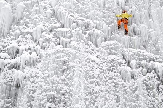 Man climbs artificial ice wall in Liberec, Czech Republic