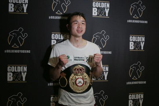 Chinese boxer Xu Can wins WBA featherweight title