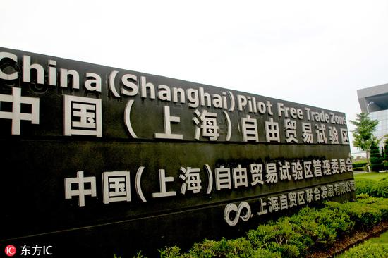 Shanghai cuts GDP target, takes on new tasks