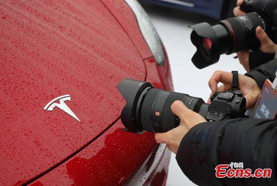 Tesla reports profits in two consecutive quarters, better-than-expected sales